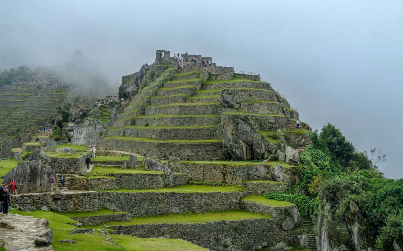 machu picchu with clouds
